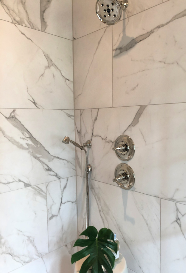 Marble shower with polished nickel fixtures