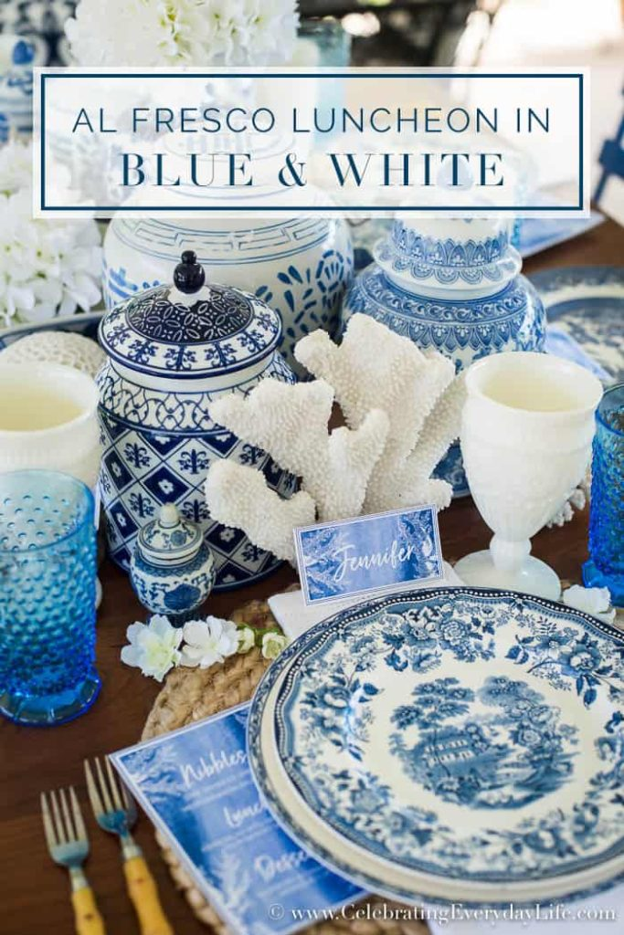 An alfresco luncheon with blue and white dishes and chinosiere