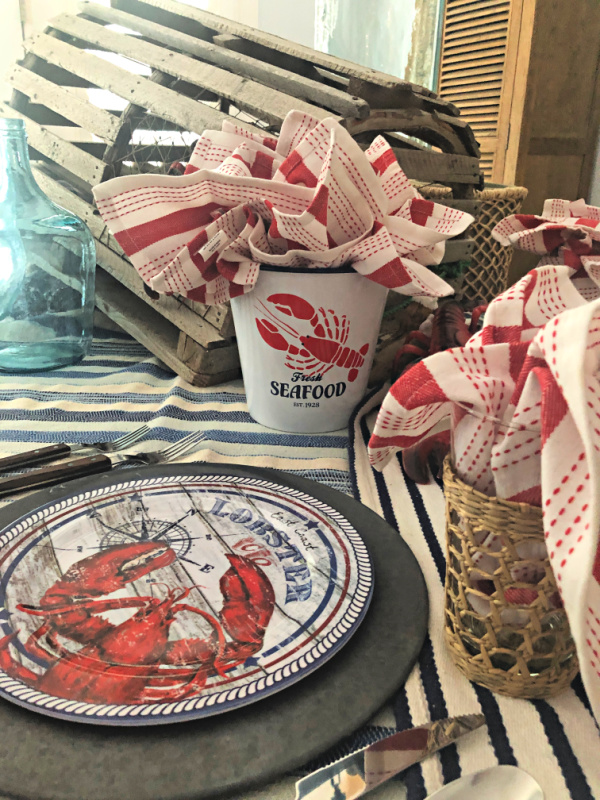 Vintage lobster trap and melamine lobster dinner plates