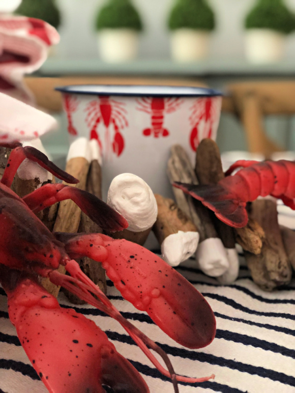 Plastic lobsters and a driftwood art piece