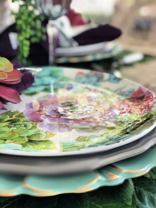 Beautiful succulent dinner plates set the scene for a succulent themed tablescape