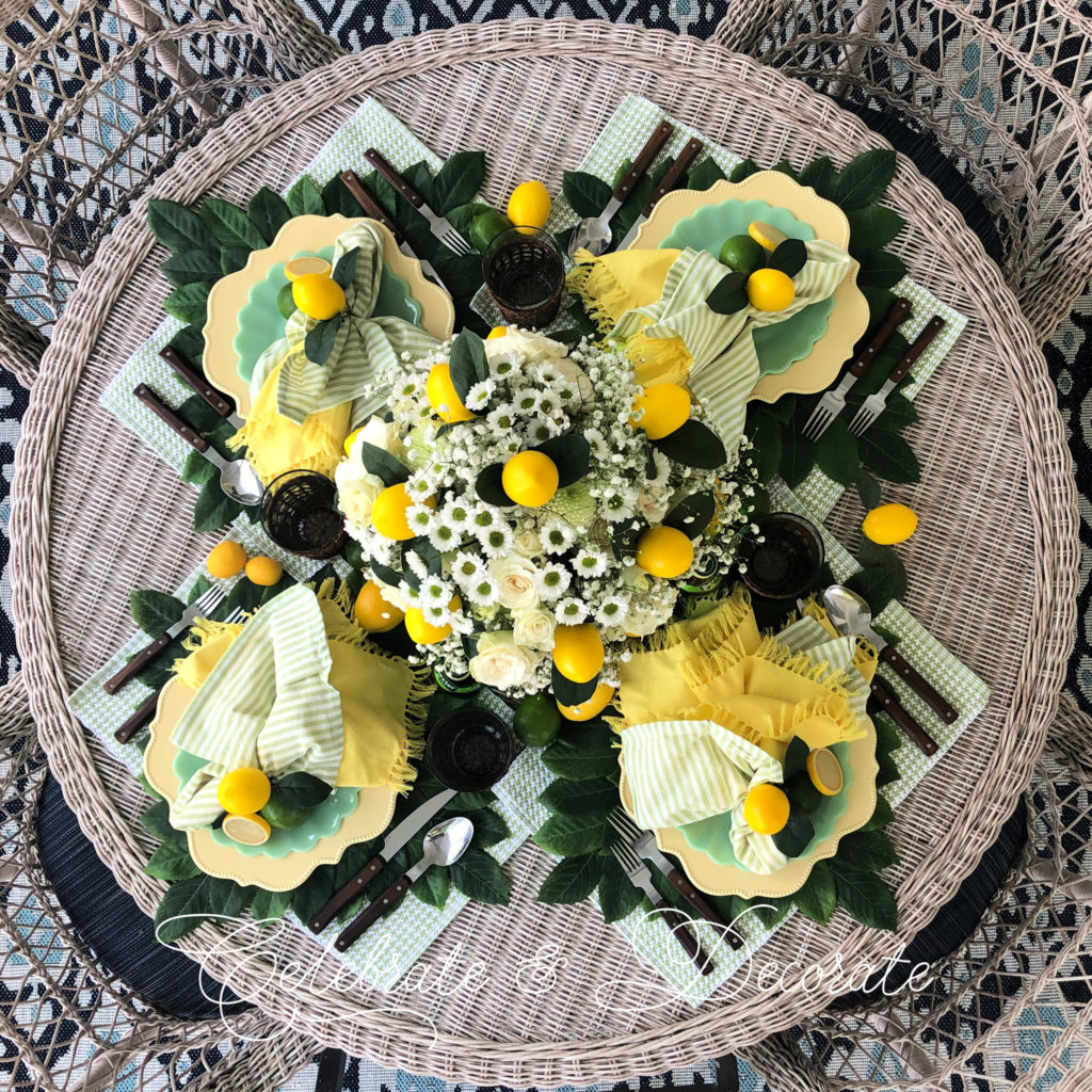 overhead shot of a yellow and green table with lemons and limes