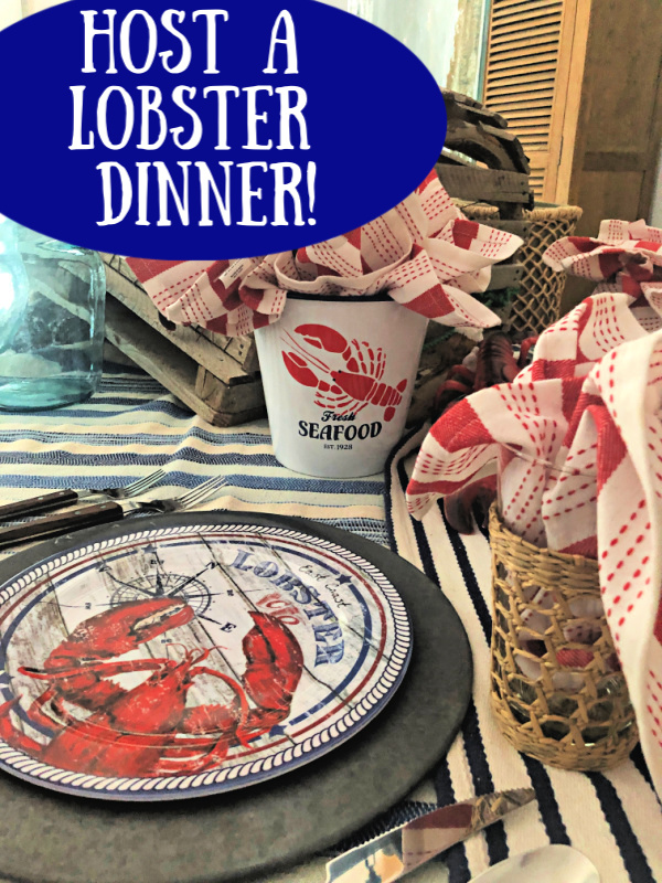Lobster tablescape with red and shite napkins and lobster printed dinner plates
