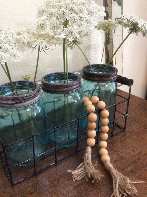 vintage mason jars with a wooden bead garland