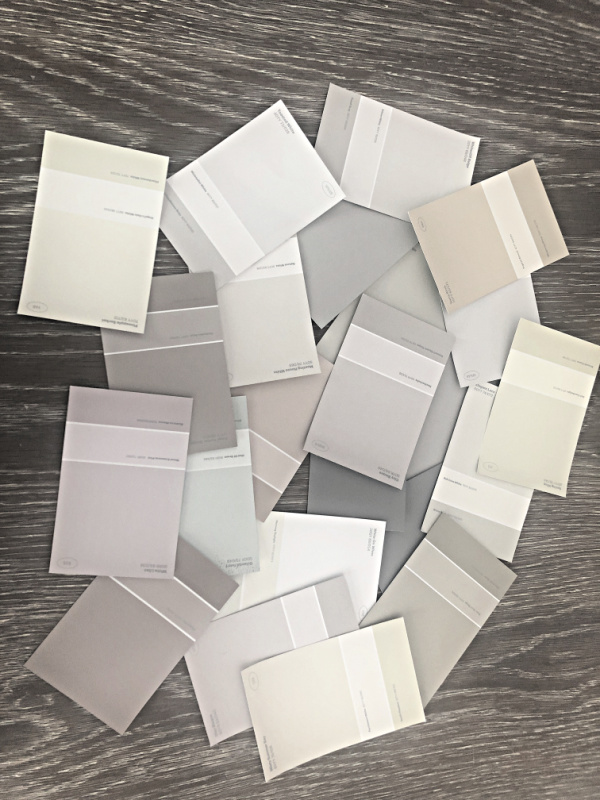 paint swatches in neutral colors spread on a tabletop