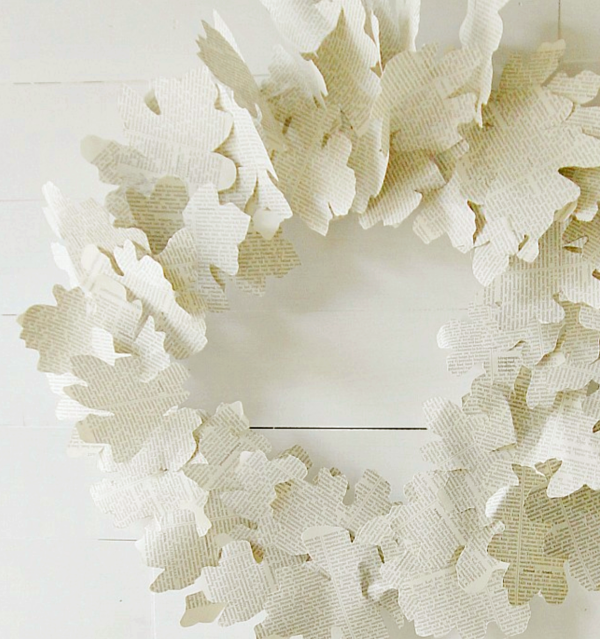 leaves cut from book pages and made into a neutral fall wreath