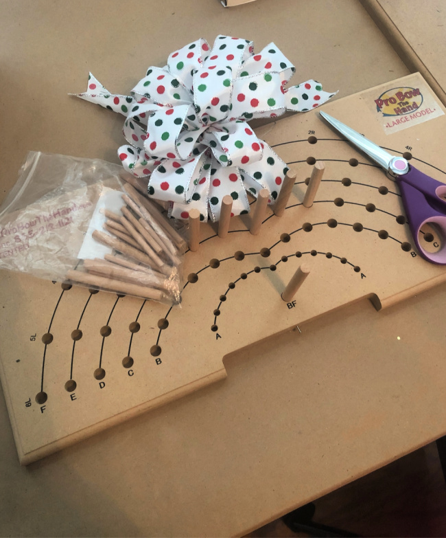 Pro Bow the hand homemade bow maker with ribbon and scissors