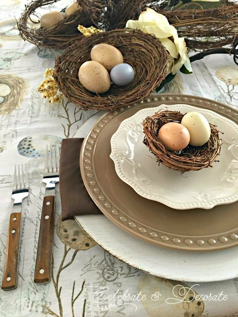 Brown and white tablescape celebrating birds with bird's nests and eggs.