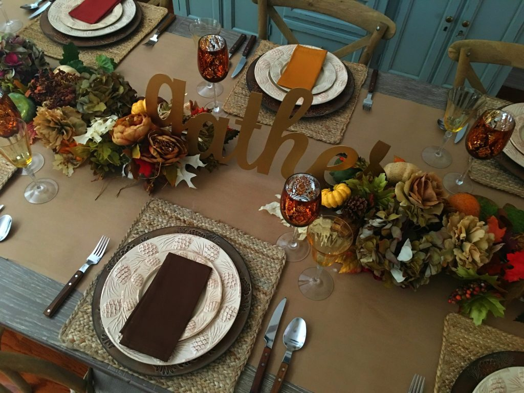 Gather script as a centerpiece for a rustic and casual thanksgiving table