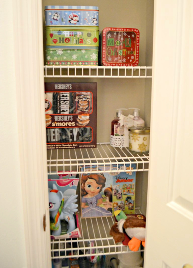 closet with wire shelves stocked with gifts for christmas