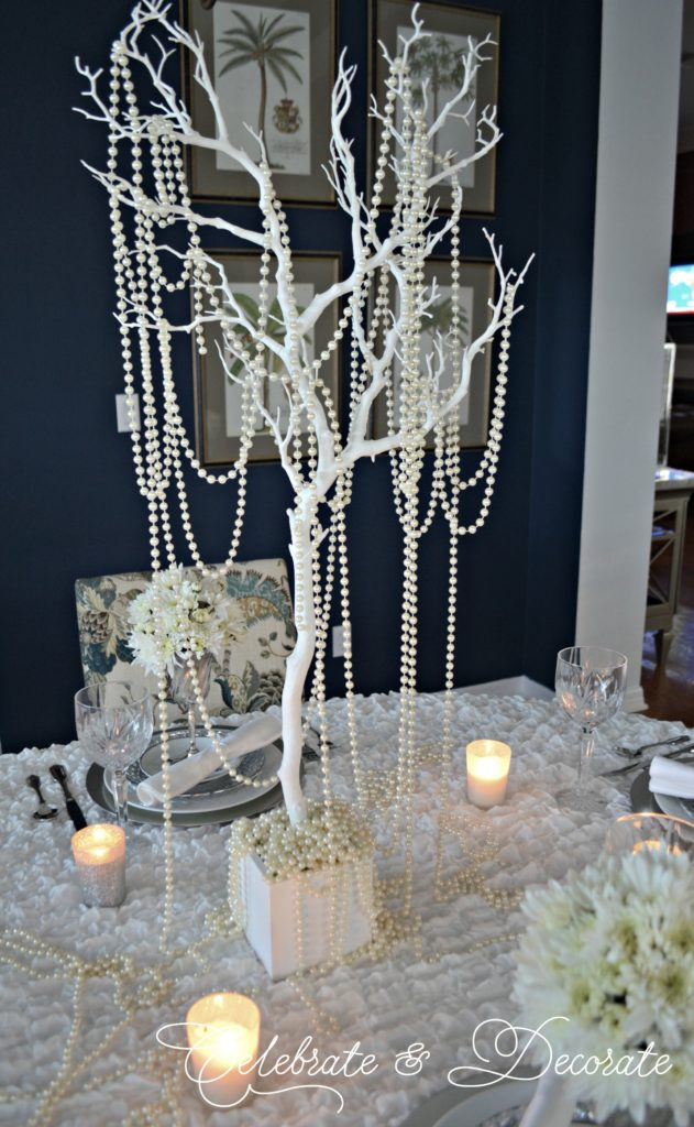 White branches with white pearls dripping from them as a winter centerpiece