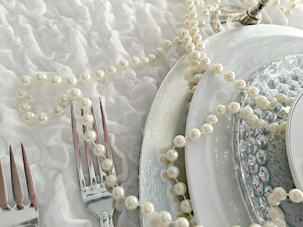 Silver flatware on a white tablecloth