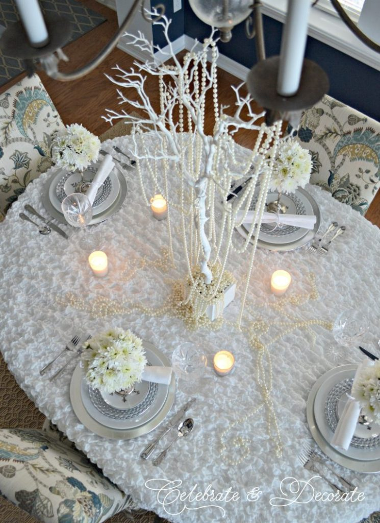 Looking down on a white and silver winter tablescape