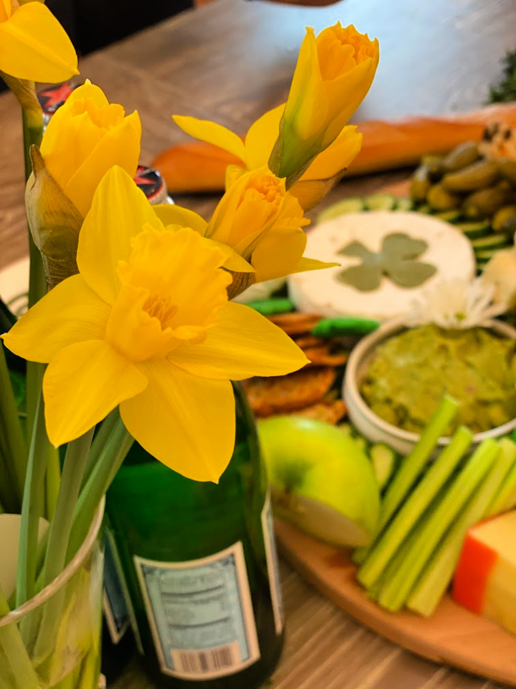 Daffodils in front of a st. patrick's day grazing board