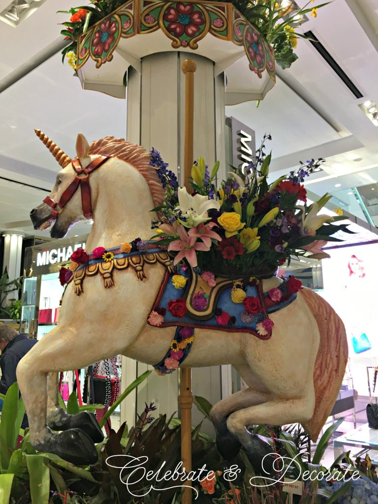 A Carousel Horse decked out with fresh flowers