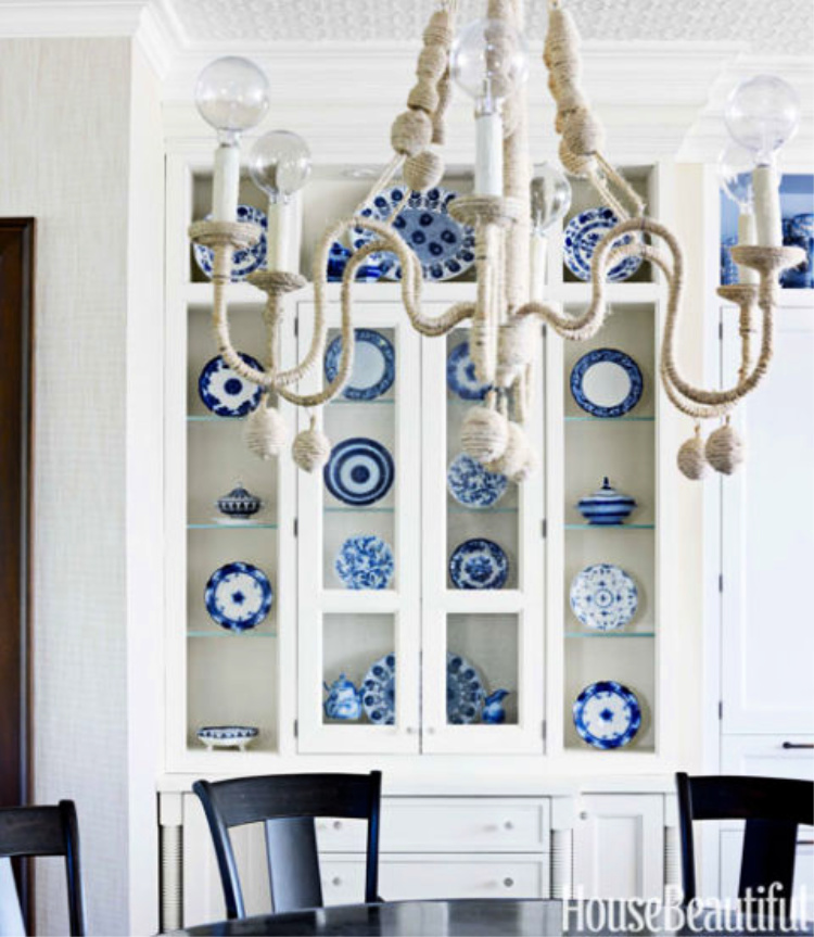 Blue and white dishes in a white china cabinet