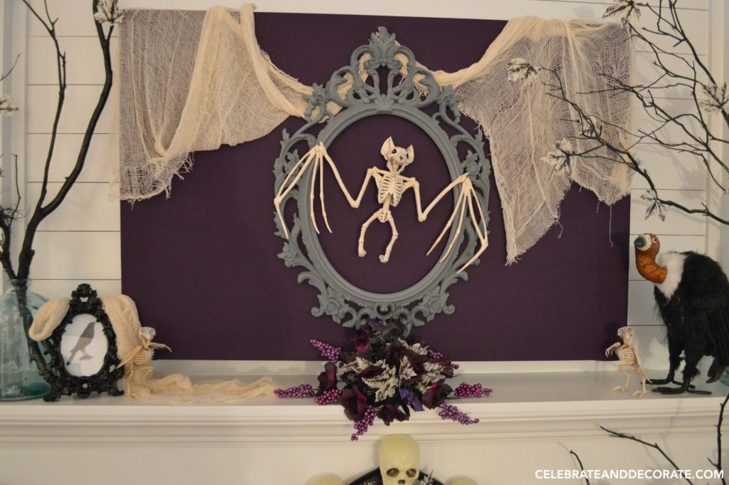 mantel decorated for halloween with a bat skeleton