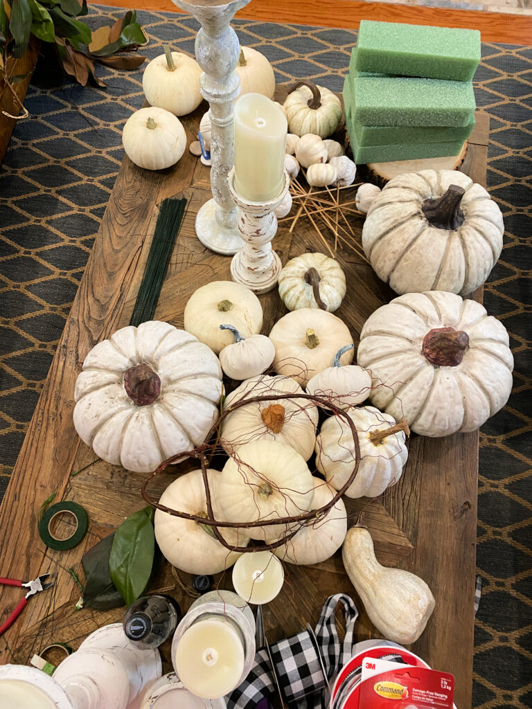 white pumpkins on coffee table ready to be styled