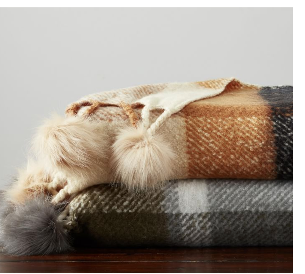 Fall plaid blankets with furry pom poms