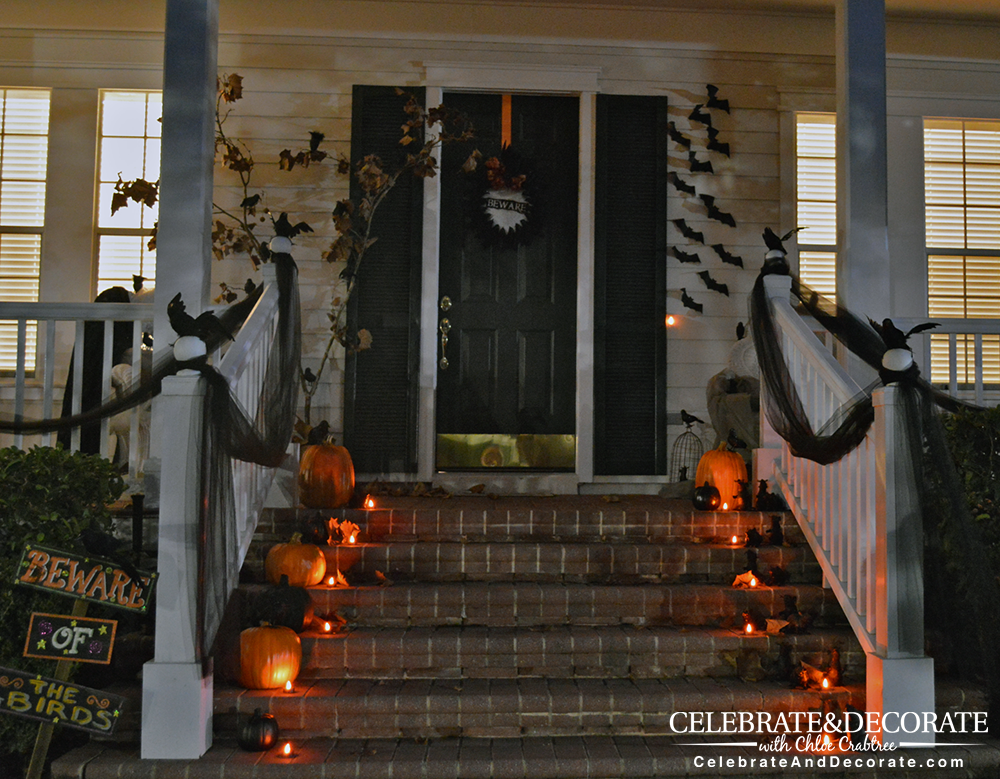 front porch at night decorated for halloween