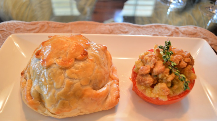 Individual beef wellington served with a stuffed roasted tomato