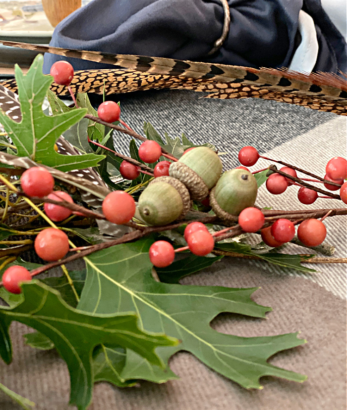 a plaid throw with acorns and berries and oak leaves
